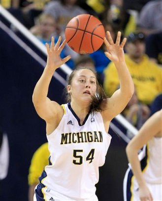 Michigan forward Kendra Seto (54) passes during the second half of an NCAA college basketball game against Ohio State in Ann Arbor, Mich., Saturday, Jan. 7, 2012. (AP Photo/Carlos Osorio)